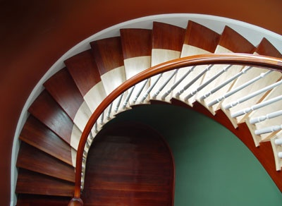 Cooper Stairworks Custom Curved Open One Side Treads: Jataba And Maple  Risers: Maple