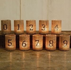 """*Reception Lighting   Wedding Ideas* ~ """"Burlap Votive Table Numbers""""   These gorgeous Burlap Votive Table Numbers are a perfect way to number your tables tops at a wedding, party or event. Each glass votive cup is wrapped in burlap and hand printed with a number. Each numbered Burlap Votive Cup measures 2.25 x 3.5. """