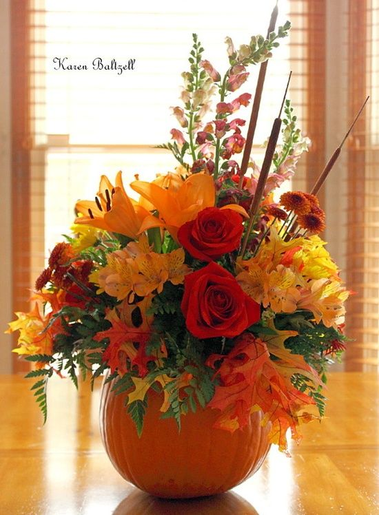 Fall Flower Arrangement  I use 3 sizes of pumpkins for fall tabletop...this one is very simple and | http://flower-arrangement-278.blogspot.com