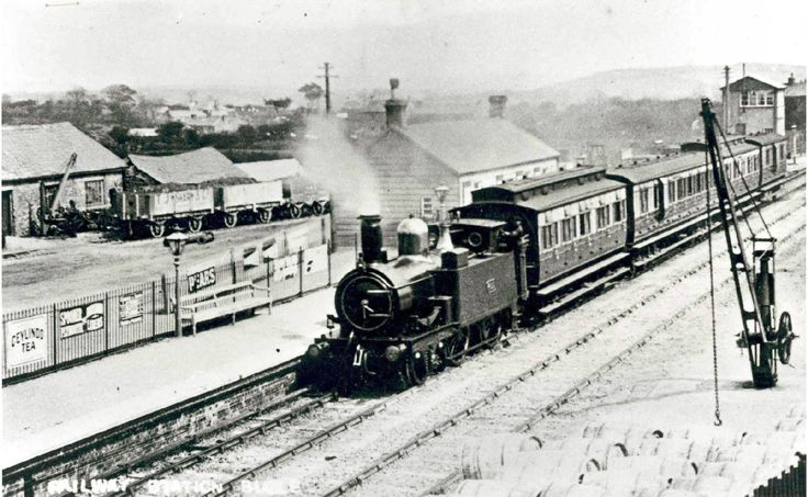 Bugle station c.1920, showing a GWR's passenger train on its way to Newquay