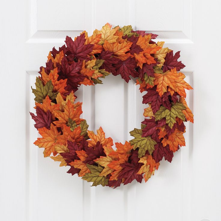Create a warm #Fall welcome for your guests by hanging a Harvest #Wreath on your front door