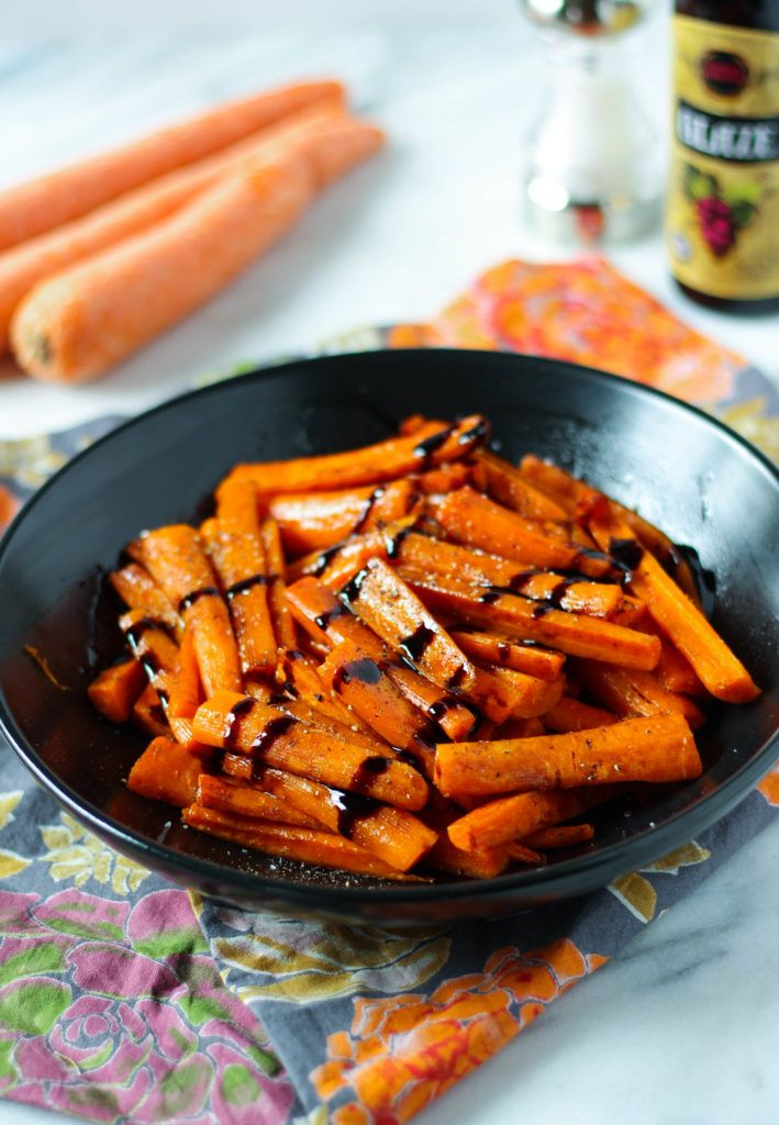 Roasted carrots make a fantastic side dish! These carrots are tossed with olive oil, garlic, salt and pepper and roasted until soft. A pre-made balsamic glaze adds a delicious finishing touch. Onward with my quest to share with you my favorite veggie side dishes! Last week I shared how to make my sauteed green beans....