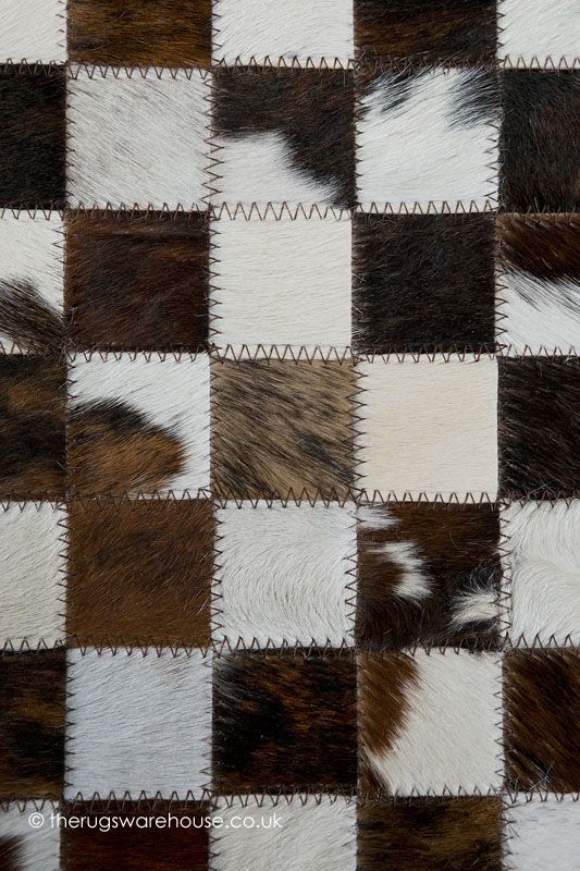 Lafitte Rug (texture close up), a handmade brown, beige & white patchwork style cowhide leather rug (6 set + custom sizes) http://www.therugswarehouse.co.uk/modern-rugs3/girona-rugs/lafitte-rug.html #luxury #rugs