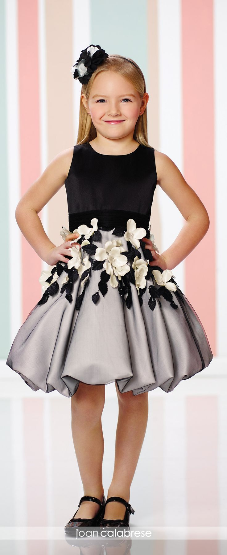 Joan Calabrese for Mon Cheri - 216321 - Sleeveless satin and tulle knee-length A-line dress with jewel neckline, satin bodice with ruched tulle waistband, large three-dimensional flowers and leaves adorn gathered tulle overlay bubble skirt.  Sizes: 2 – 14  Color: Black/Ivory