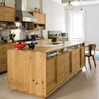 The island and cabinets, fashioned from remilled Douglas-fir beams salvaged from upstate New York, sport inexpensive drawers from Ikea. T...