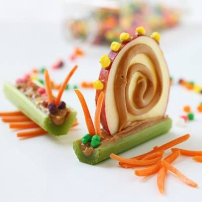 Who says you can't play with your food? Create these fun afterschool snacks with the kids using apple slices, celery, a bit of peanut butter and some shredded carrots.