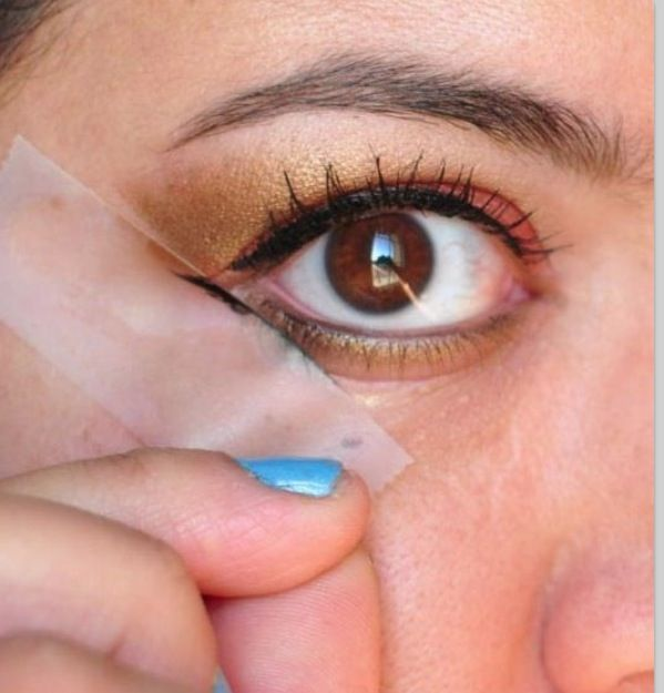 Sneaky way to get a nice straight line of eye liner.... With tape as your help