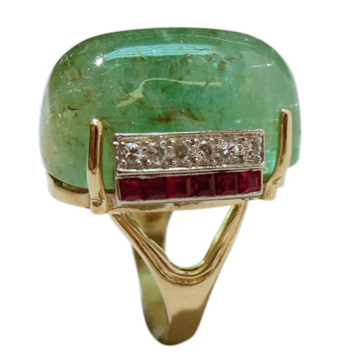 19th C. Mughal Empire Emerald mounted as a Ring and featuring Art Deco Diamond and Ruby appliqués. The 14K Gold setting is modern.