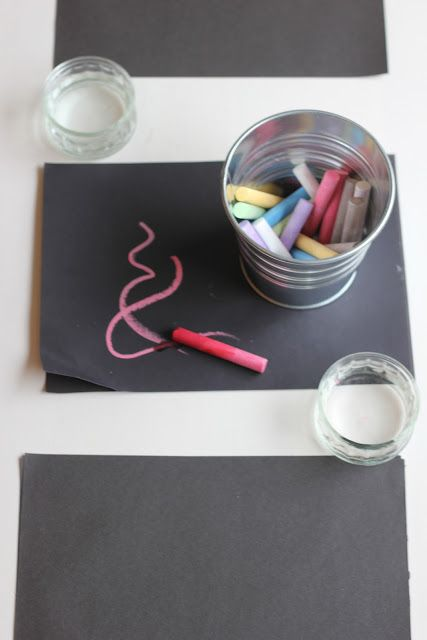 Invitation for children: Drawing with wet chalk on black paper.. nice idea!