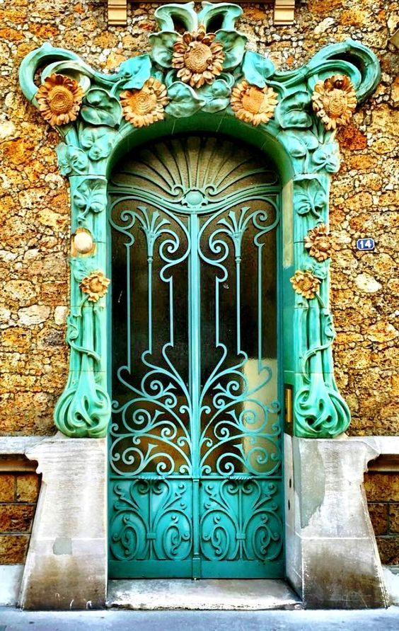 Colorful aqua blue and gold door and entrance