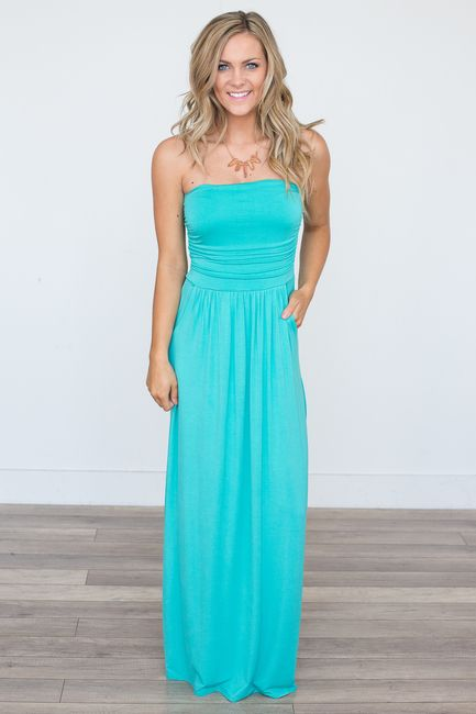 Shop our Solid Strapless Maxi Dress. Available in black, jade, and wine. Free shipping on all US orders!