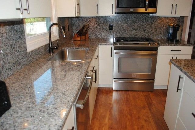 White Kitchen Cabinets With Caledonia Granite Countertops