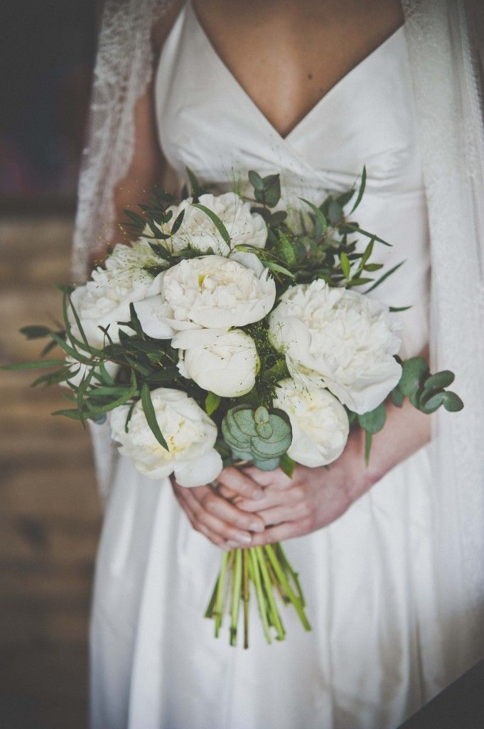 White peony bouquet with natural foliage