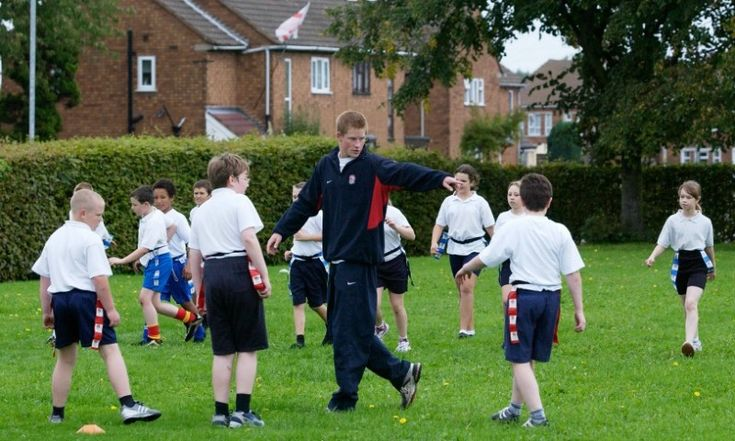 Game time! Harry took some time out of his schedule to coach tag rugby to schoolchildren at Greenfield School in Walsall, United Kingdom in 2004.