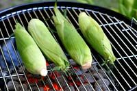 """Grilled corn. """"The best way to grill corn is to cook the corn in their husks, directly on a hot grill. The husks protect the corn from getting dried out and the corn essentially steams in its own moisture. If you are working with fresh corn, there really is no need to soak the corn in water first as called for by some. The smokey corn husks impart a wonderful flavor to the corn as well."""""""