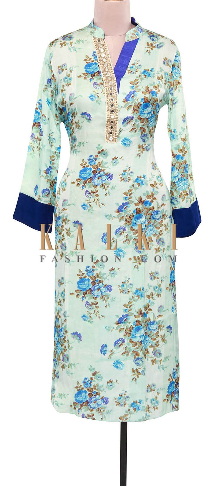 Buy Online from the link below. We ship worldwide (Free Shipping over US$100). Product SKU - 309152.Product Link - http://www.kalkifashion.com/cream-and-blue-floral-printed-kurti-adorn-in-mirror-embellished-placket-only-on-kalki.html