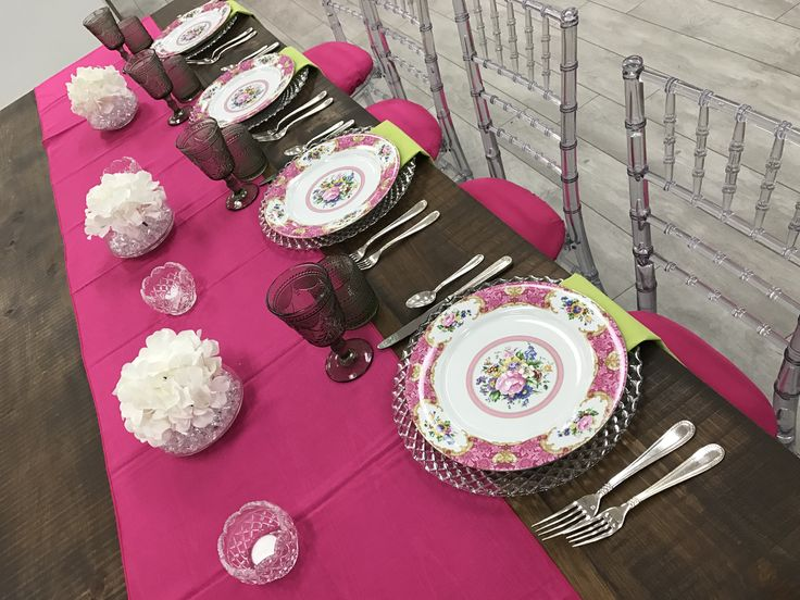 Brighten a dreary winter day! Harvest Table, Vintage Floral Plates, Smoke Grey Renaissance glasses, Regency flatware, Clear Chiavari chair with Fuchsia seat caps and runner.  Chair-man Mills  By Kim Gardiner