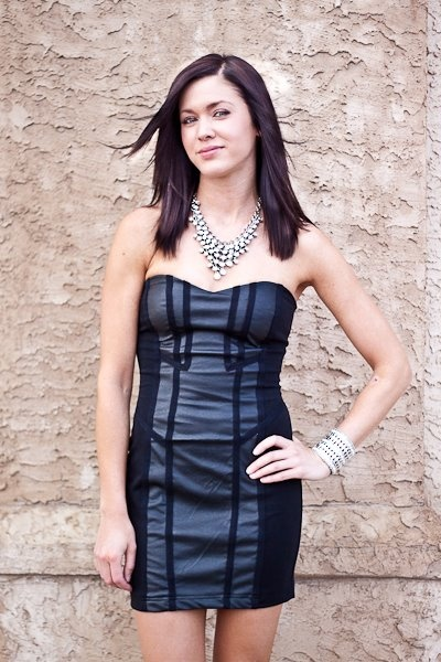 A nice edgy twist to your typical Little Black Dress!! Leatherette details to give your dress some oomph in pictures!!