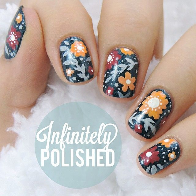 This autumn, we have our eyes on navy. Maybe a design like this for an accent nail? Art by @infinitelypolished.
