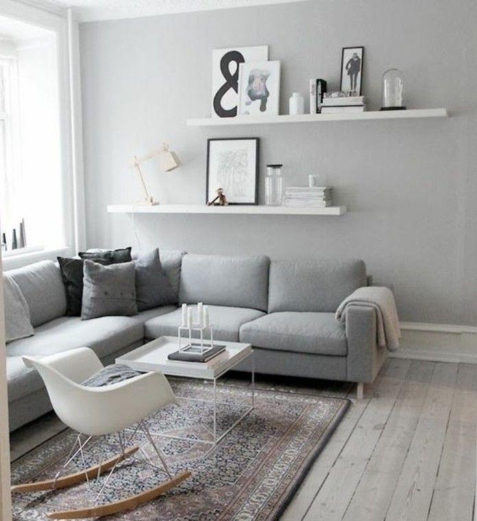 superbe idée pour un salon gris et blanc, sobriété et design, canapé gris, chaise à bascule, table à café minuscule, style scandinave