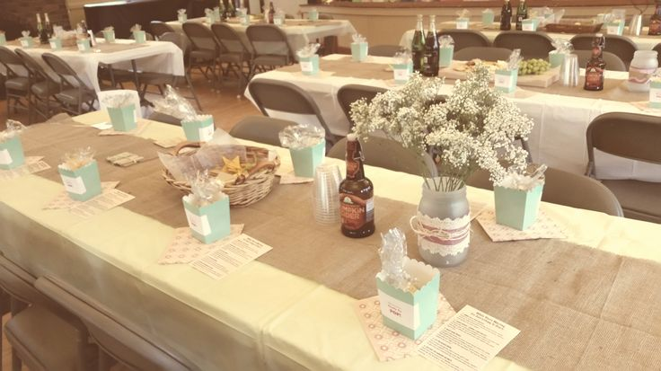 """Each table setting had a container of popcorn """"She is about to POP"""" (hehe cute right?). A coordinating napkin, and a place card explaining all the games and activities for the event."""