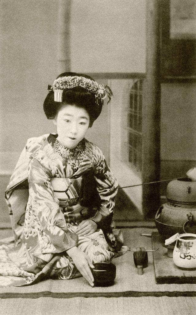 """Osaka maiko Yachiyo II, performing a hakobi-temae, tea ceremony, 1910s. Hakobi means """"to carry"""", temae means """"the ritual preparation of tea""""."""