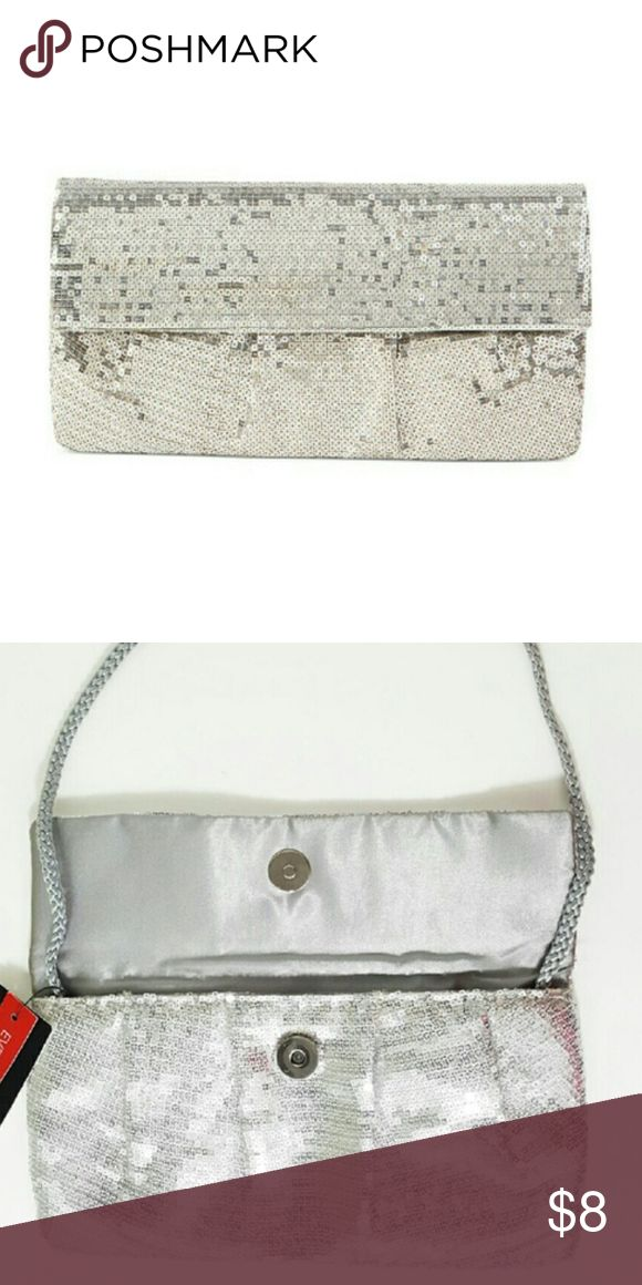 "LIKE NEW Style & Co. Silver Sequin Sparkly Clutch Get ready for your special night by grabbing this beautiful Style & Co silver sequin clutch! Has a fabric shoulder strap that allows you to wear it as a small purse, or can be tucked inside to make it a clutch. Has a silky black interior lining and small interior pocket. In excellent, barely-used condition! The  dimensions are: 9""w x .25"" d x 5"" h. Comes from a pet-free and smoke-free home. I have many like-new and new items, be sure to check…"