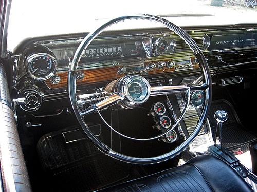 1963 Pontiac Grand Prix.  Mine had a 389 TriPower, gold w/white leather interior.  Loved that car.