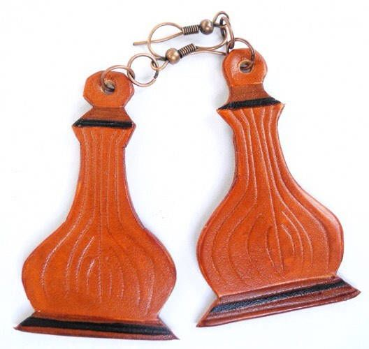 A personal favourite from my Etsy shop https://www.etsy.com/listing/575614981/onion-roof-leather-earrings-hand-cut