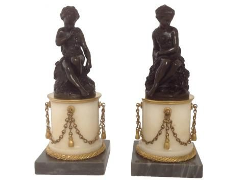 A Pair of Napoleon III Antique Bronze Figures on Gilt Mounted Marble Plinths. A small pair of finely cast and chased French, Napoleon III, Patinated bronze figures on gilt bronze mounted marble bases.
