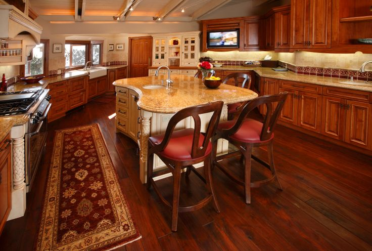 Lush cherry wood tones throughout the flooring and ...
