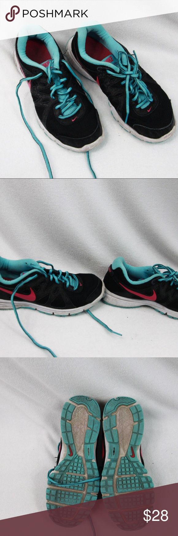 Nike Revolution 2 Running Shoes Sz 7.5M Nice pair of Nike Revolution 2 running shoes in size 7.5 M. See pics for wear. Some slight sole wear at heels, some dirt on white side soles. Not used much for running, mainly walking. Nike Shoes Athletic Shoes