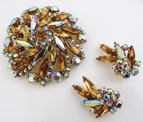 Absolutely stunning rhinestone set with large floral design brooch with an intricate placement of aurora borealis stones as well as beautiful navette amber colored ones. Earrrings are marked with a patent number, but no pieces are signed with a designer name. #thetiechest  #vintagejewelry