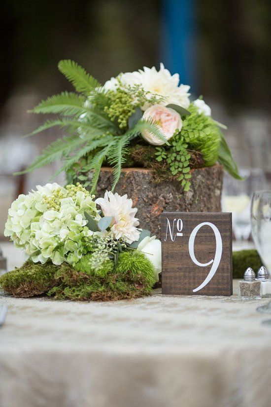 Tree stump moss and floral centerpiece / http://www.deerpearlflowers.com/greenery-fern-wedding-ideas/