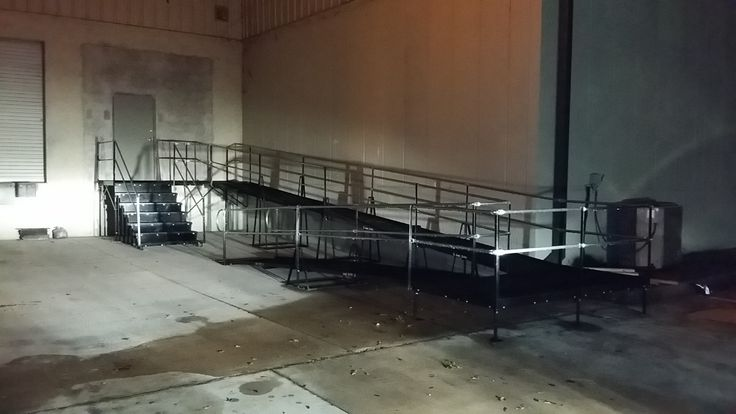 The Amramp Tampa team worked into the night to complete this 48-foot wheelchair ramp and six-stair system for a warehouse for the Feeding America Organization in Longwood, FL.