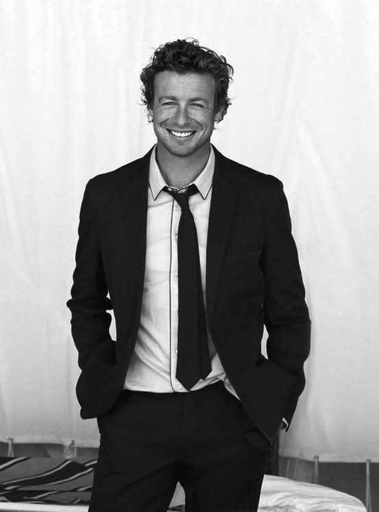 Simon Baker - I think he has the most heart-stopping smile I've ever seen.  There's just so much joy in it.