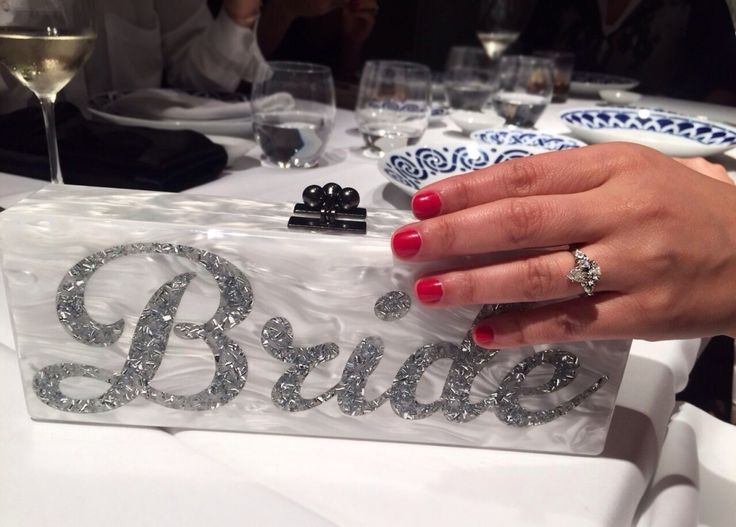 "THE BRIDE AND THE RING ! Clutch master Eddie Parker knows how to spoil a girl about to get married. That is something we are also very good at!  A match made in ""wedding-heaven"", the Danelian Diamond Club ring, the Bride clutch and a pre-wedding weekend in Barcelona."