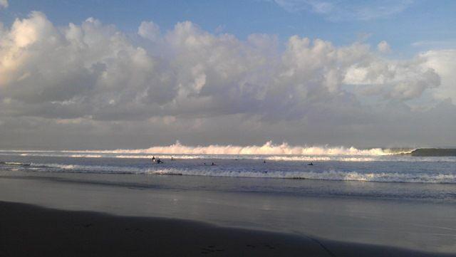 Surfers at Seminyak Beach, Bali