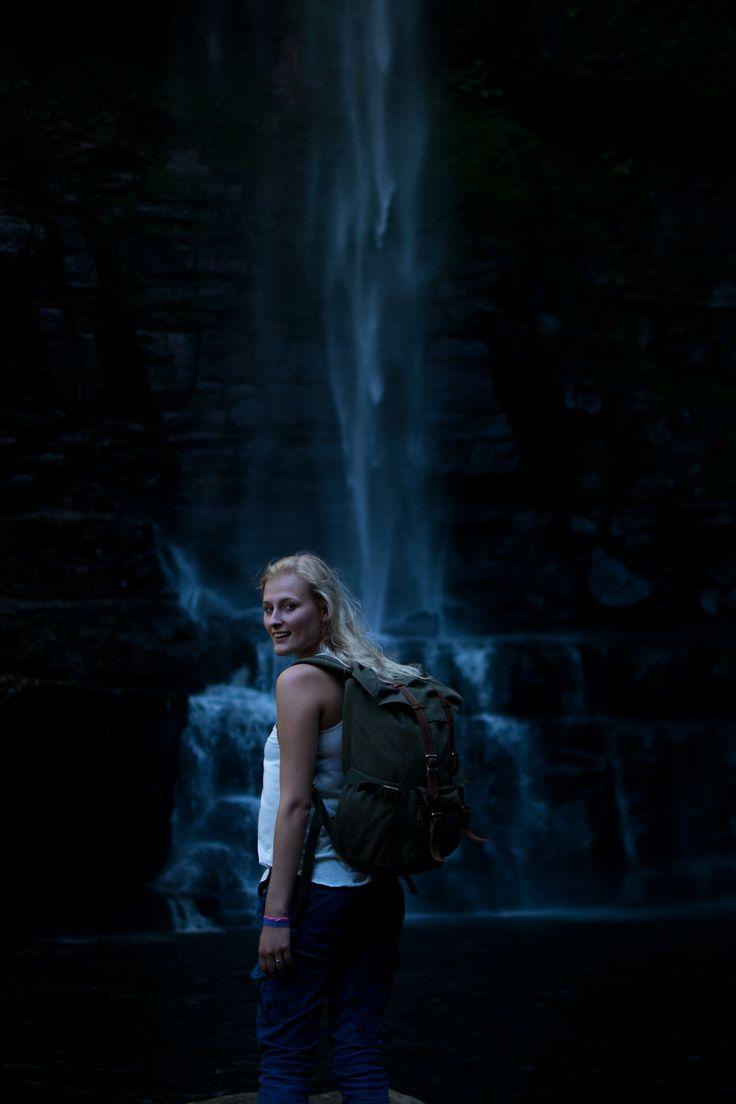 Vintage canvas backpack at Belmore falls, Australia NSW