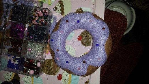 First attempt at a donut. Bead box for size reference.