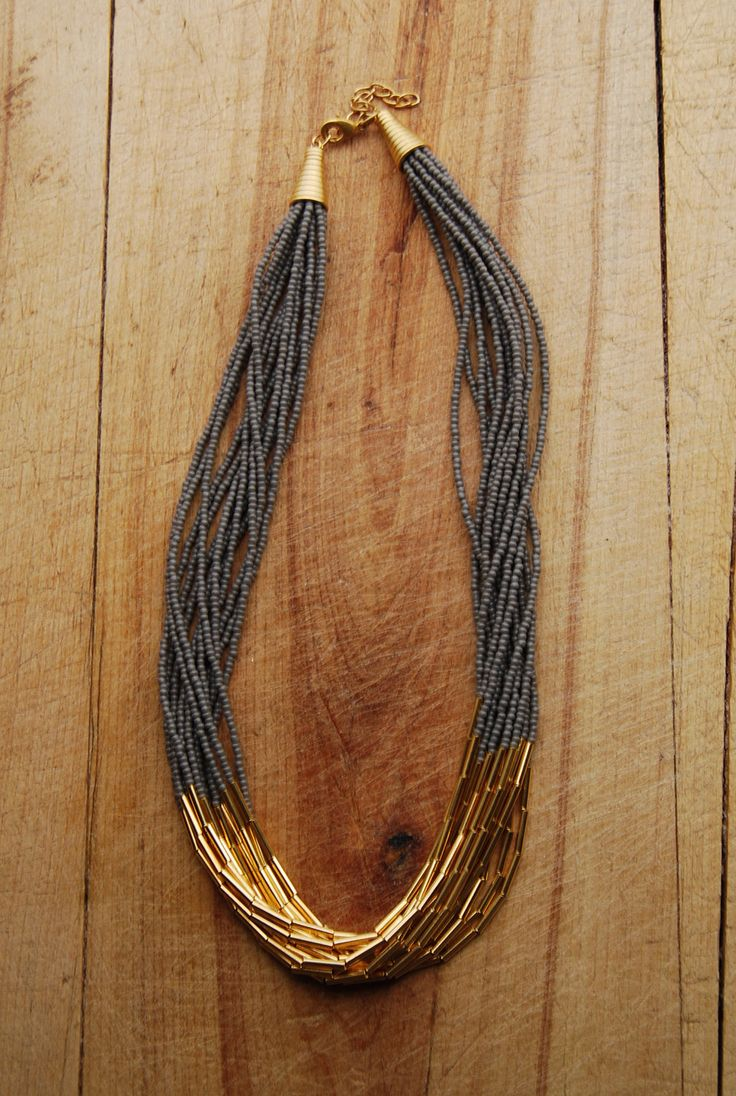 Grey and gold elegant minimal beaded multistrand necklace. $42.00, via Etsy.