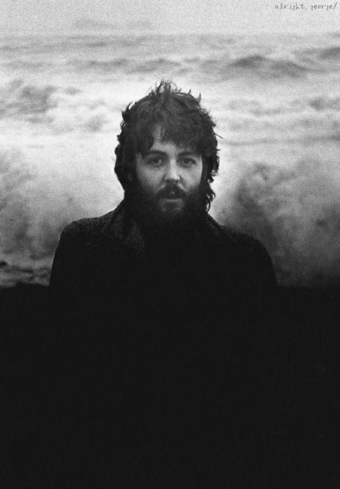 A bearded Paul McCartney at the beach.