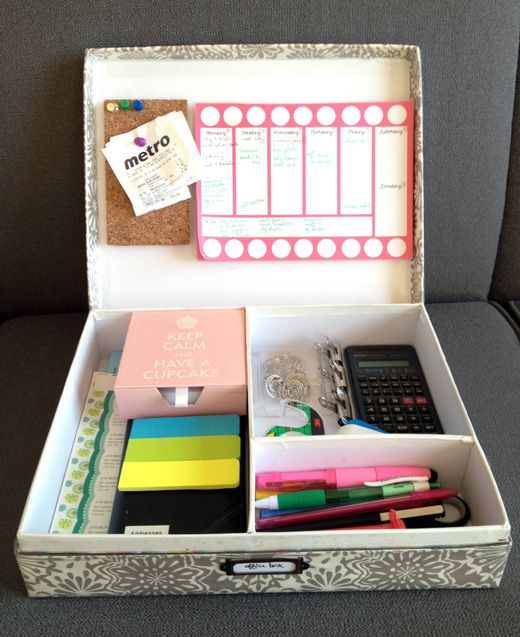 an office box: box covered with wrapping paper on outside and with magnetic stick-on pieces and corkboard attached on inside - fantastic idea!