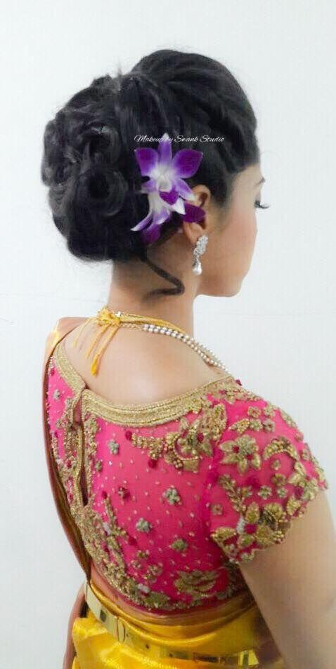Indian bride's reception hairstyle by Swank Studio. Bridal updo. Saree Blouse Design. Hair Accessories. Tamil bride. Telugu bride. Kannada bride. Hindu bride. Malayalee bride. Find us at https://www.facebook.com/SwankStudioBangalore