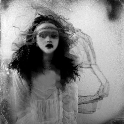 """Melinoe (Μελινοε, """"Dark Thought"""", from melas, black, and noe, mind) was the ancient Greek goddess of propitiation-offerings made to the deceased. She wandered the earth every night with a train of ghosts, scaring anyone in their path. This was said to be the reason that dogs would bark at seemingly nothing at night. (She and her ghost train stalked the earth invisibly). She was said to be the daughter of Zeus, who took the guise of Hades and sedu..."""
