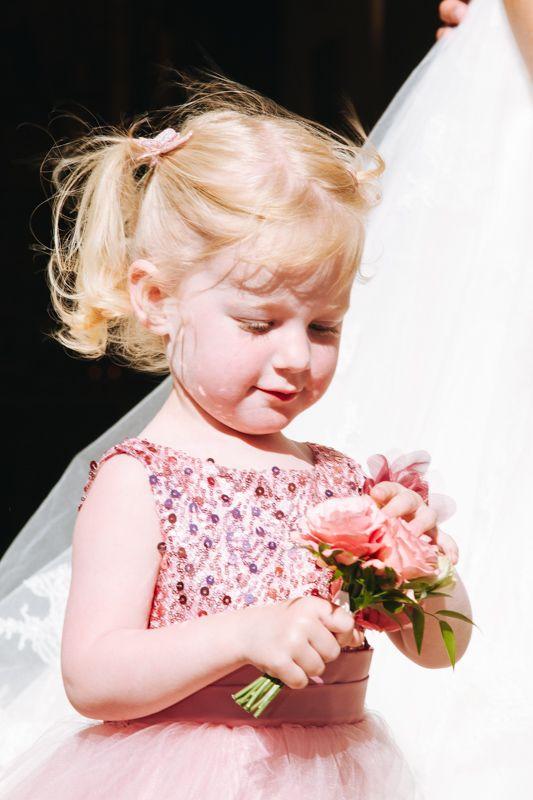 Little Lilly admiring her boquete.  http://blog.beautifulwedding.no/elin-og-eivind-26-06-2015/