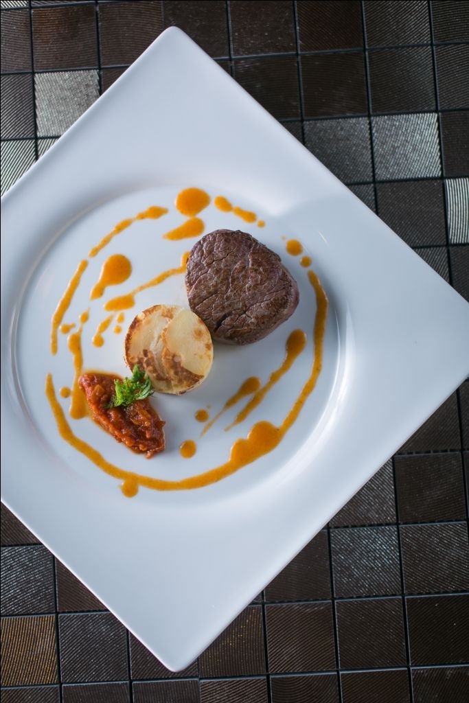 Beef tenderloin with Pommes Anna, Hungarian ratatouille and paprika gravy
