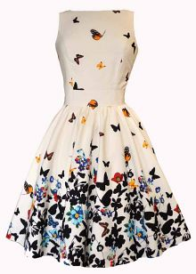 Beautiful White Butterfly Tea Dress with a bump ponytail, nude pumps, thin bangles, and coral or plum lips