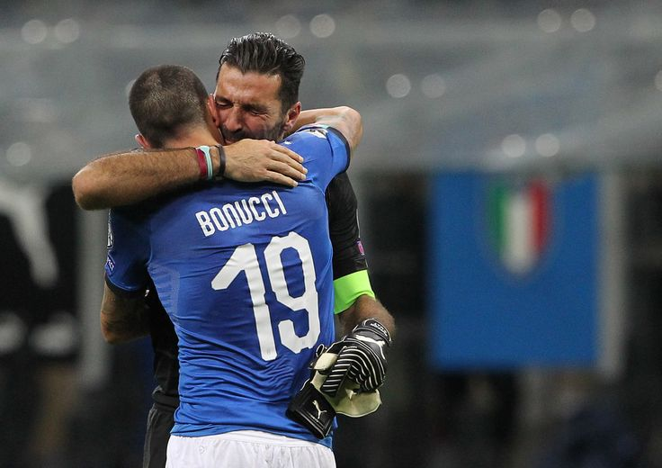 Gianluigi Buffon and Leonardo Bonucci of Italy dejected at the end of the FIFA 2018 World Cup Qualifier Play-Off: Second Leg between Italy and Sweden at San Siro Stadium on November 13, 2017 in Milan, Italy.