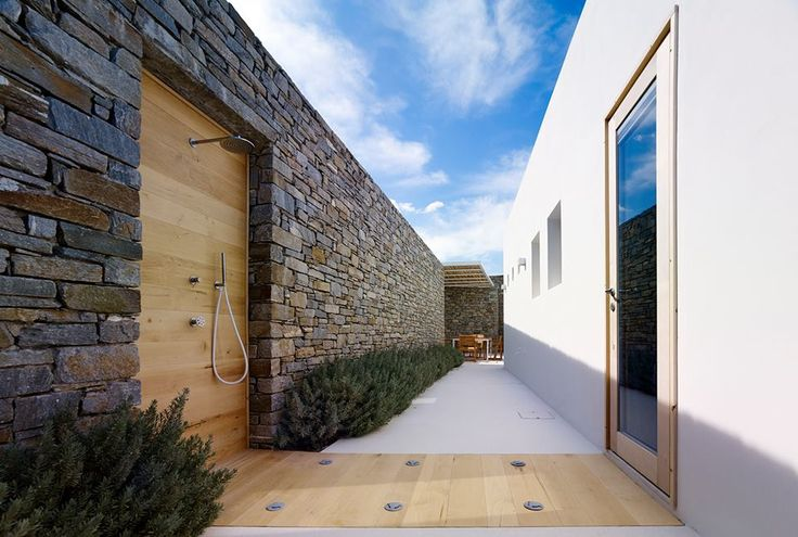Outdoor shower for a stunning summer residence in Paros island/ Accoya wood boards from KritikosWood